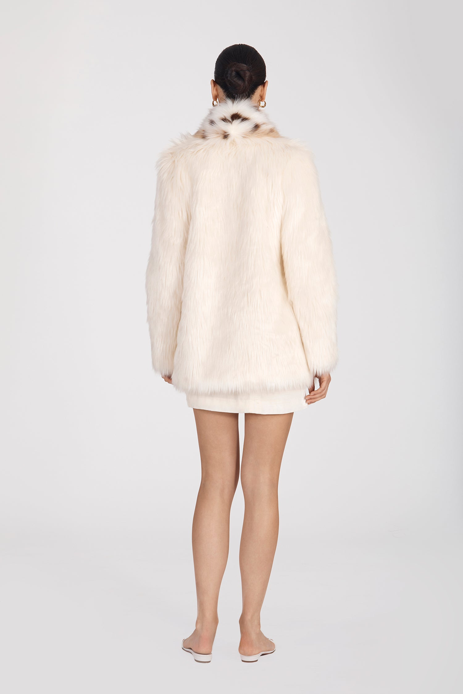 Marei1998's Tiger Lily Faux Fur Coat In White Color. Featuring Oversized Silhouette And Shawl Collar. Spotted Collar Design Contrasts The Elegant White Hue, Creating A Chic Look. As Worn By The Model. Back View. Resort 2020 Collection - Furless Friendship.