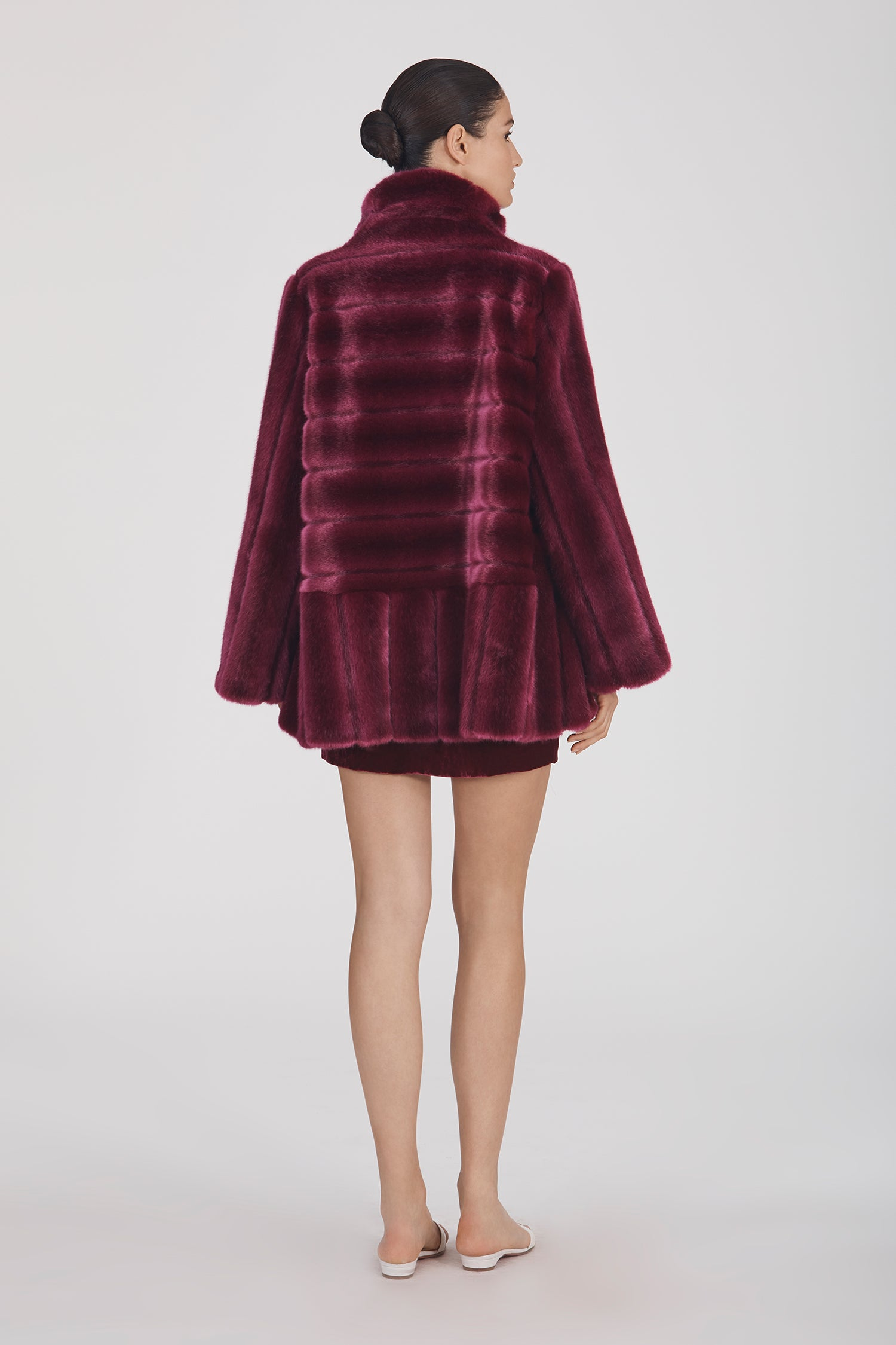 Marei1998 Yoshino Coat In Bold Raspberry Hue. Perfect For Cold Weather, This It Is Made From Plush Faux Fur, Which Feels So Warm And Comfortable. Cut In A Slight A-Lined Shape And Fully Lined, It Is Ideal For Smooth Layering. Side View.