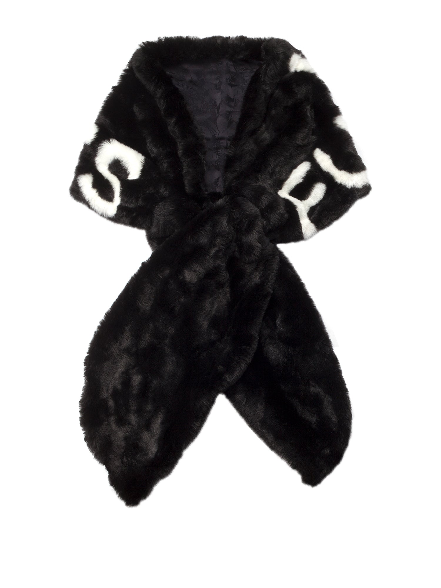 A Packshot Of Marei1998's Furless Faux Fur Stole In Off White Color. Exclusively Designed As Part Of Marei1998's Furless Label, This Stole Is A Bold Statement Piece. Cut In A Wide Silhouette, It Is Crafted From Plush Faux Fur In Black Color, Featuring White Jacquard Design. Front View.
