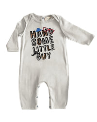 front image of baby boys cream romper with 'Handsome little guy' printed on front