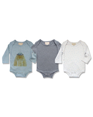 front image of triple pack onesies, one with walrus, one with blue stripes, one with blue stars on white base