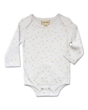 front image of white long sleeved onesie with beige stars all over