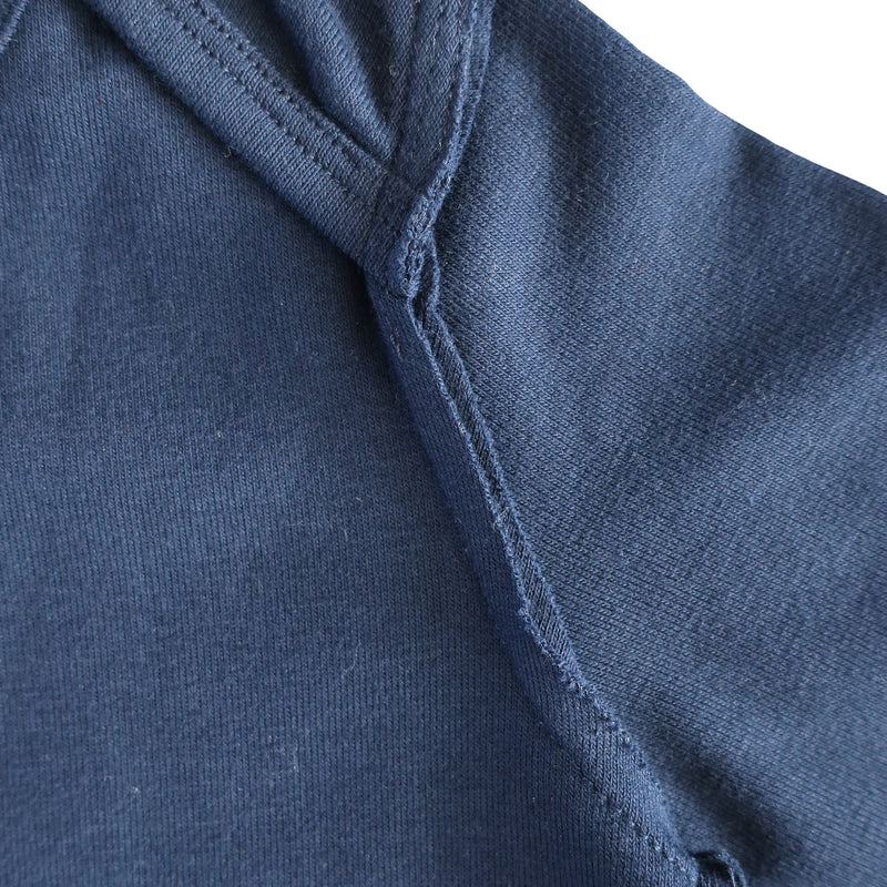 close up image of raw edge detail on navy romper