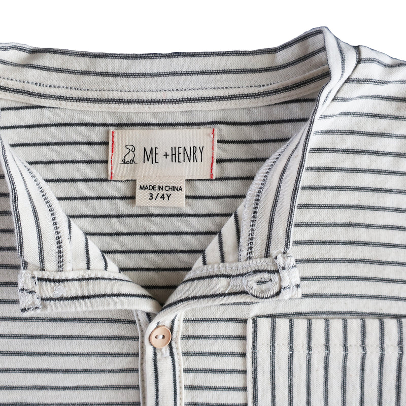close up image of long sleeved Henley tee with ecru and grey stripes and pocket