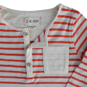 close up image of slub cotton orange and cream striped Henley tee