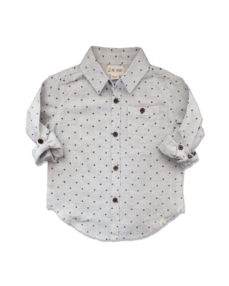 front image of cotton grey woven shirt with navy spots all over with sleeves rolled up
