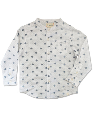Front image of white woven round neck long sleeved shirt with navy polka dots all over