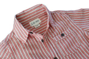 close up image of long sleeved cotton orange striped woven shirt