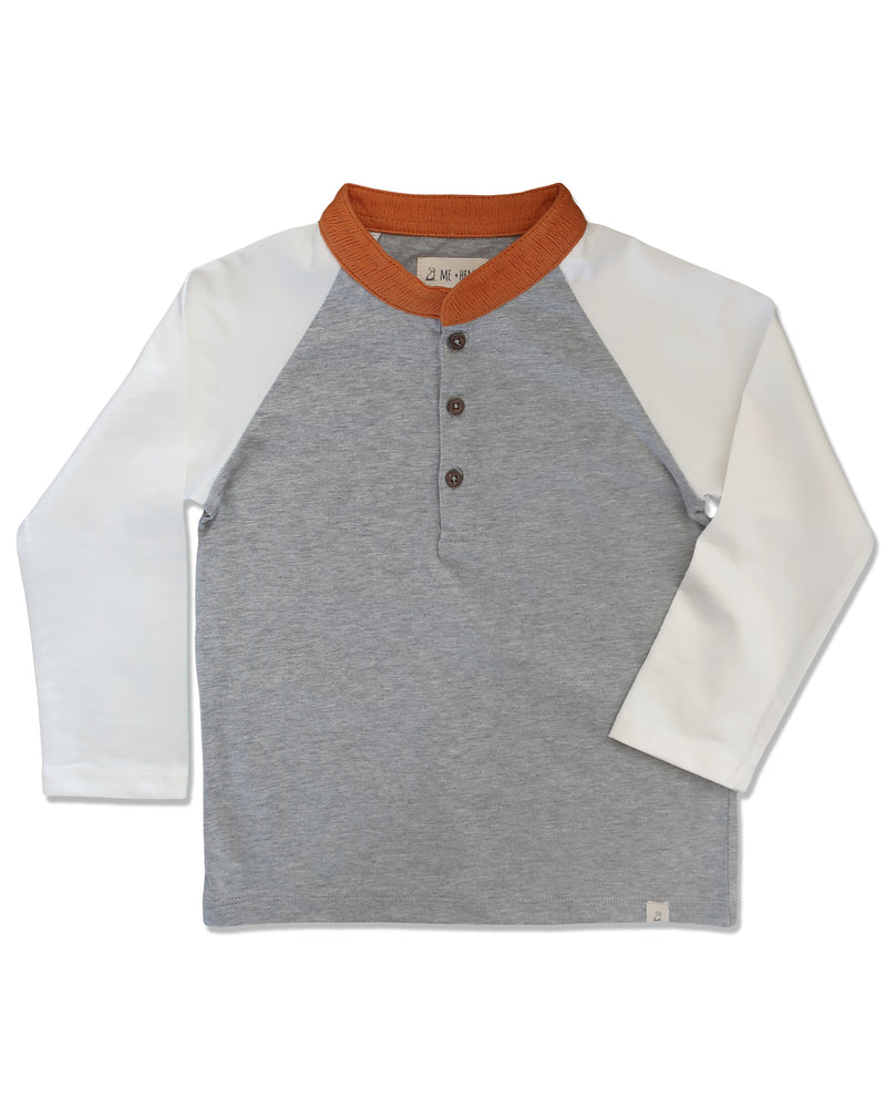 front image of grey raglan tee with orange collar and white arms
