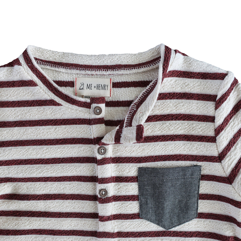 close up image of loop back cotton fabric burgundy and cream striped Henley tee