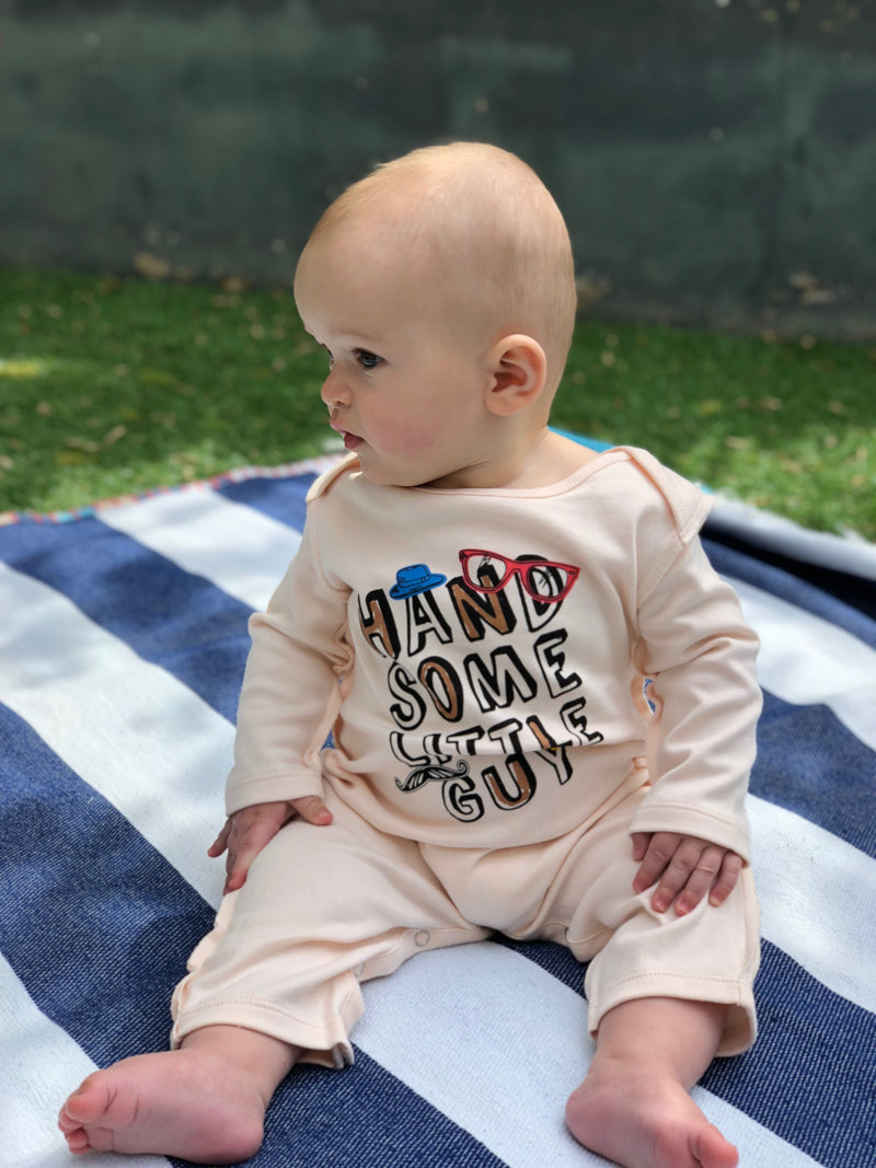 baby boy sat on grass wearing Handsome Little Guy romper