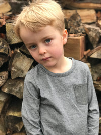 image of boy wearing long sleeved black striped tee with pocket