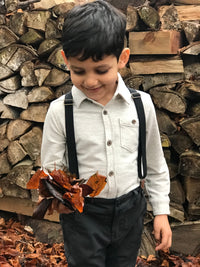 boy wearing black plaid pants with suspenders
