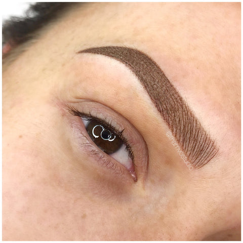 Defined brunette brows with a combination of microblading and shading tattooing at Tham Vo Studio Melbourne