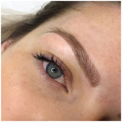 Girl with blue eyes, fresh brow feathering tattoo at Tham Vo Studio Melbourne
