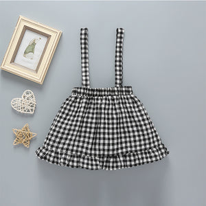 2-Piece Solid Color Top And Black And White Plaid Back Belt Skirt