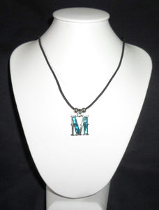 """M""  Letter ""M"" necklace made from Abalone Paua shell ."