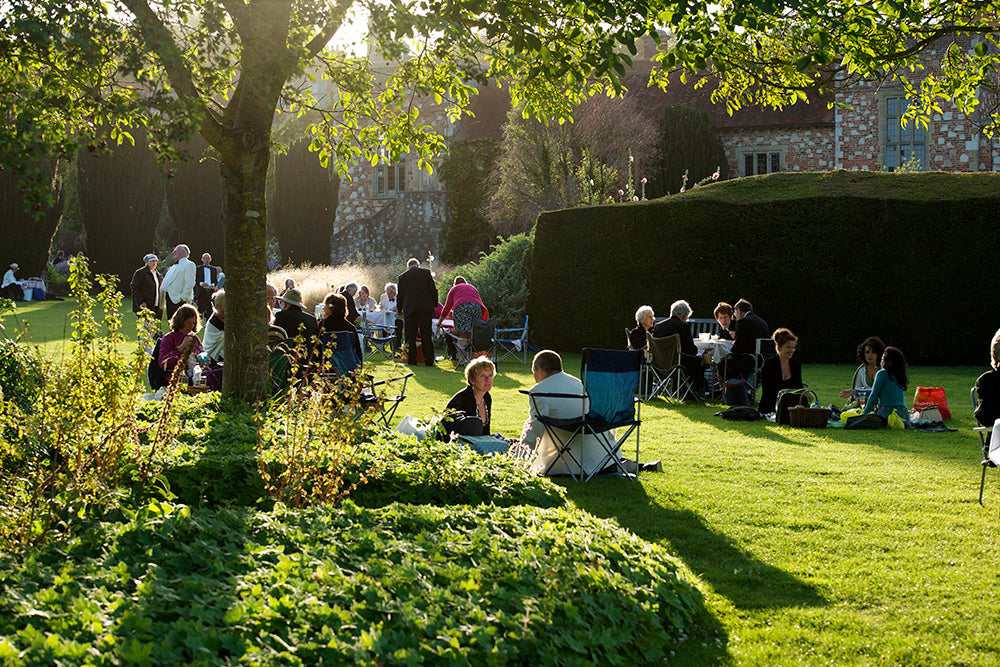 People picnicking in the garden at Glyndebourne opera