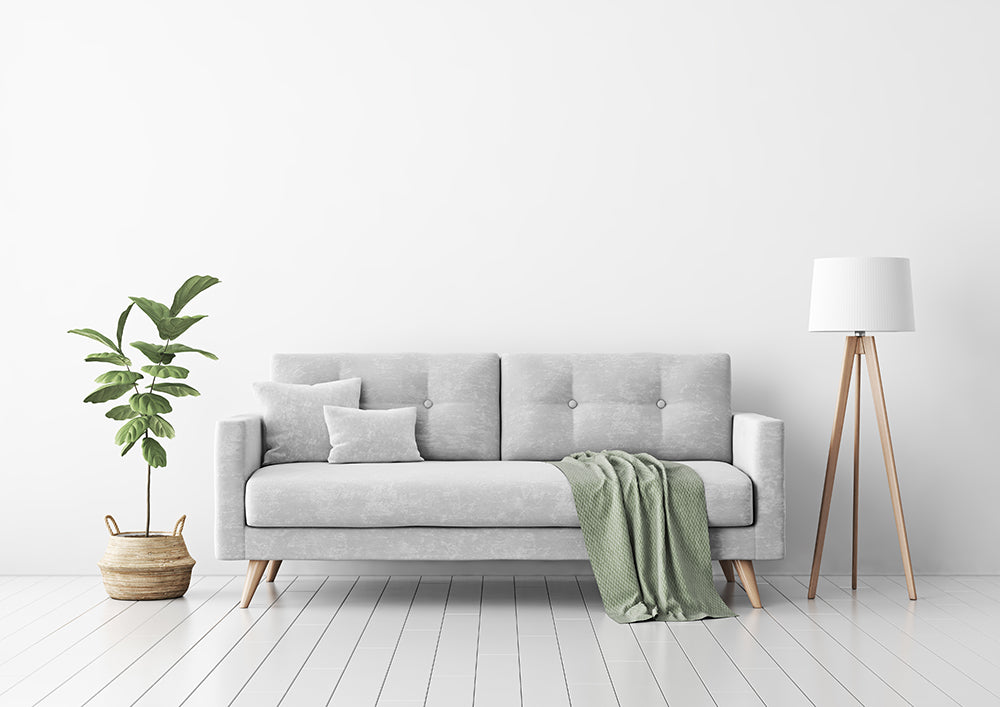 Neutral grey sofa with a green decorative throw