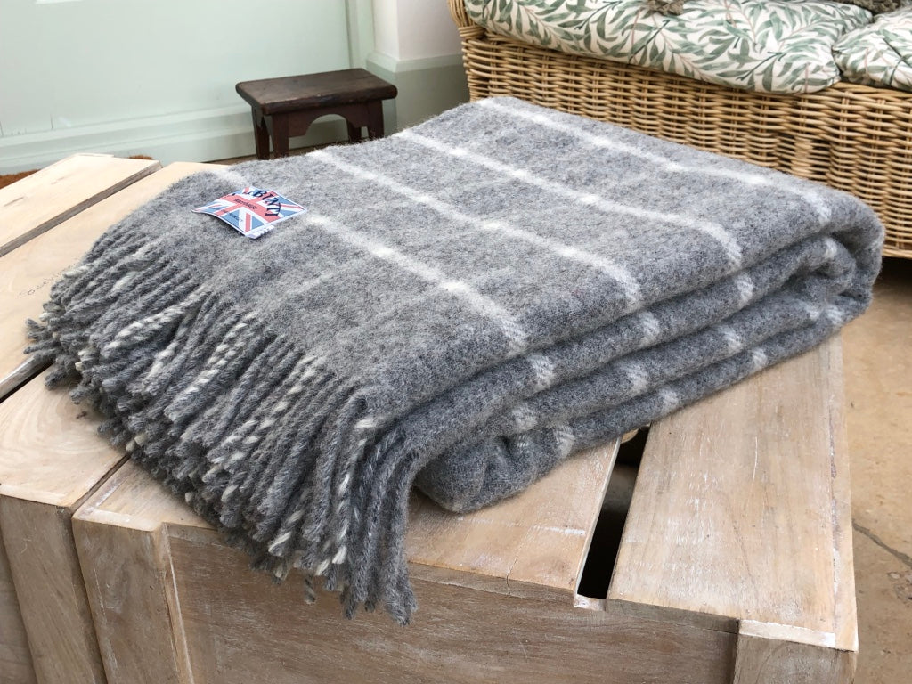 Style idea using a grey wool throw folded up on a coffee table