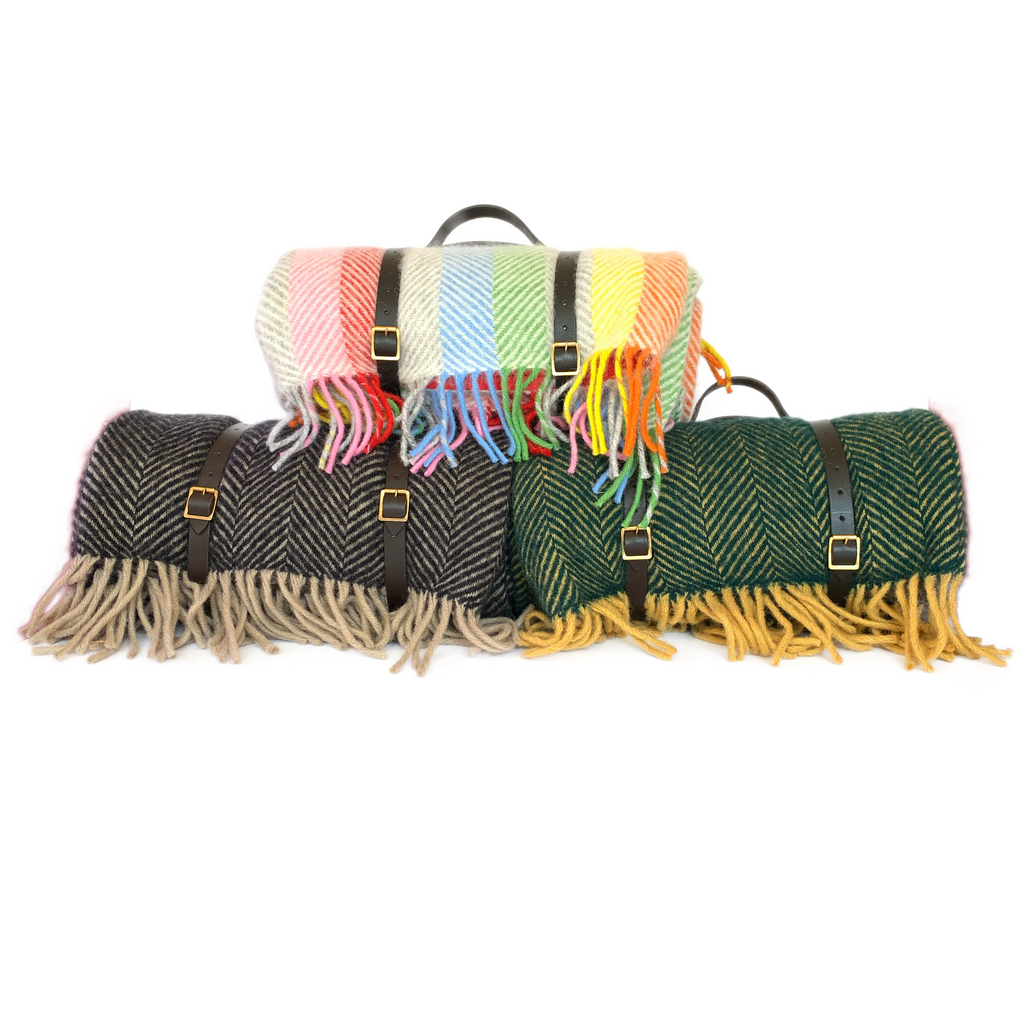 Three wool picnic blankets with waterproof backing and leather straps