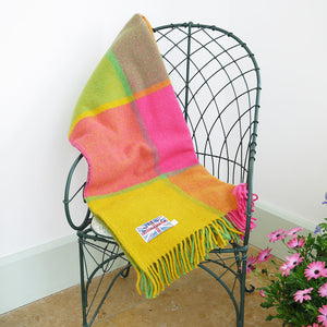 Citrus wool throw on a chair