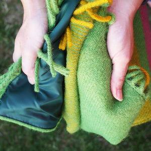 Close up of the citrus waterproof wool picnic blanket showing backing and quality of the wool.
