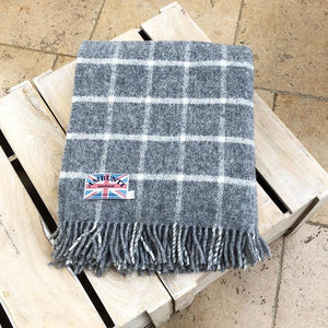 grey check wool throw in a conservatory