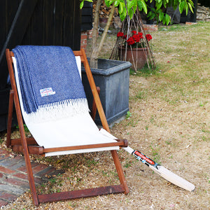 navy herringbone throw on a deck chair