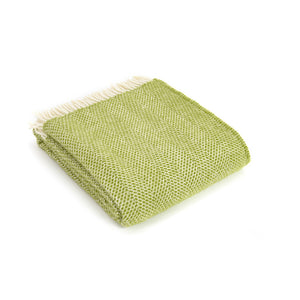 green beehive wool throw folded up