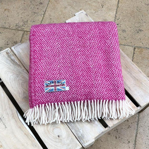 cerise wool thorw folded up on top of a table