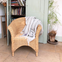 grey beehive wool throw draped over a conservatory chair