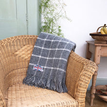 block check grey throw draped over a chair