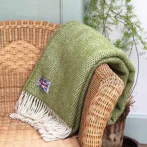 green welsh wool throw folded up over the back of a chair