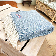 large folded up welsh wool throw folded up