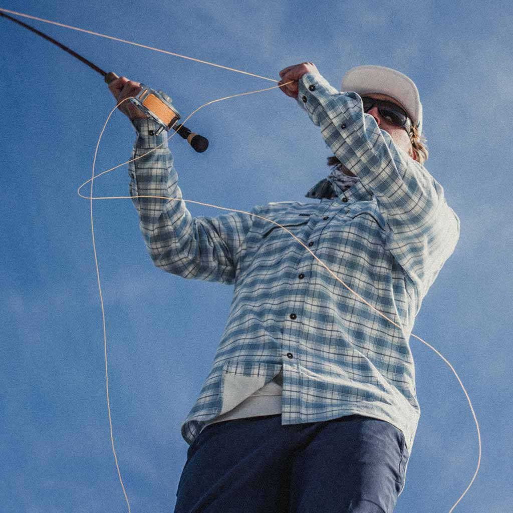 Photo of man fishing in Blue Bisom shirt