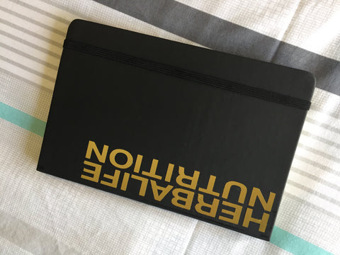 Black journal with gold branding