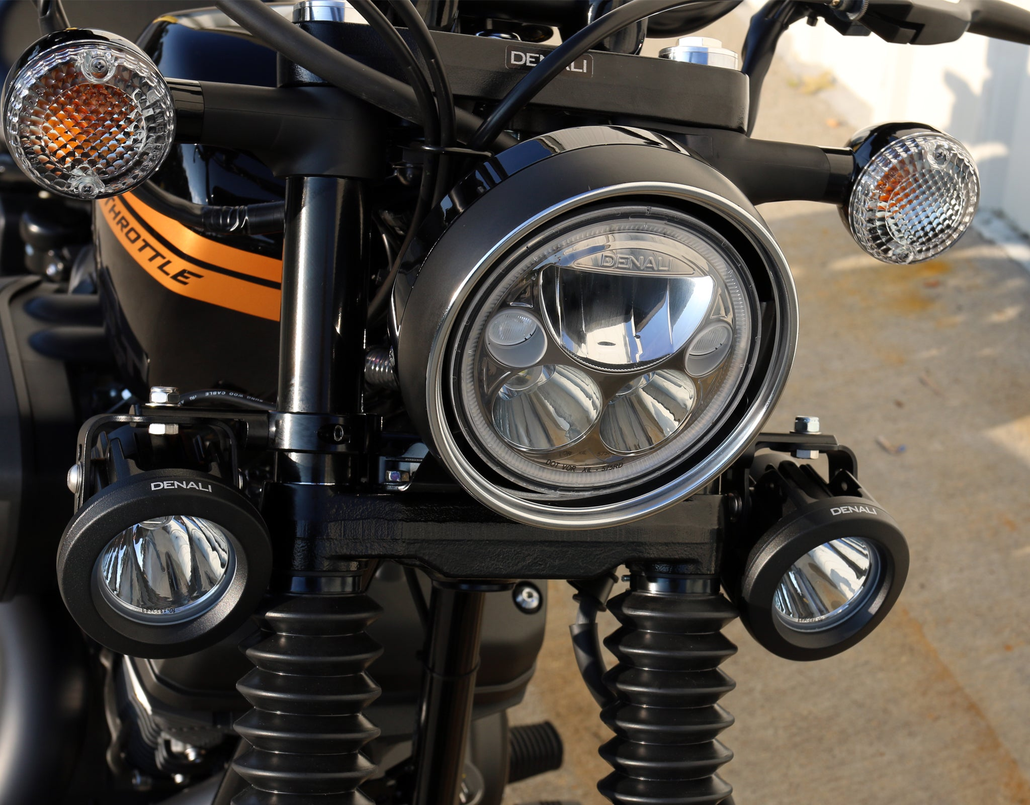 M7 LED Headlight mounted in factory headlight bucket & DR1 Light Kit mounted using the Universal Fork Tube Light Mount