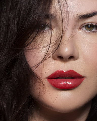Close up shot of girl with glossy red lips