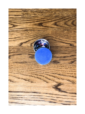oulis tin repurposed as gift filled with plastic pearls on wooden floor