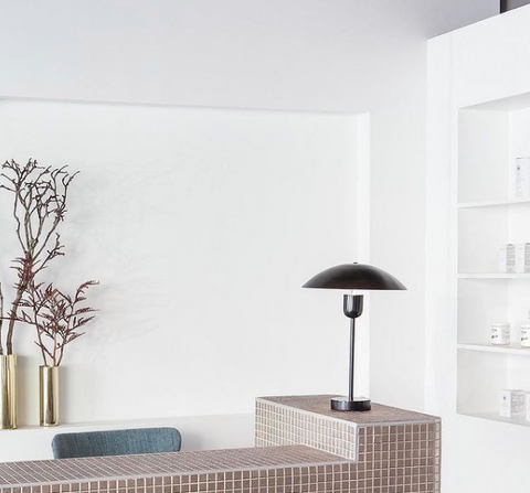 spa desk clean and simple with tiles and white wall