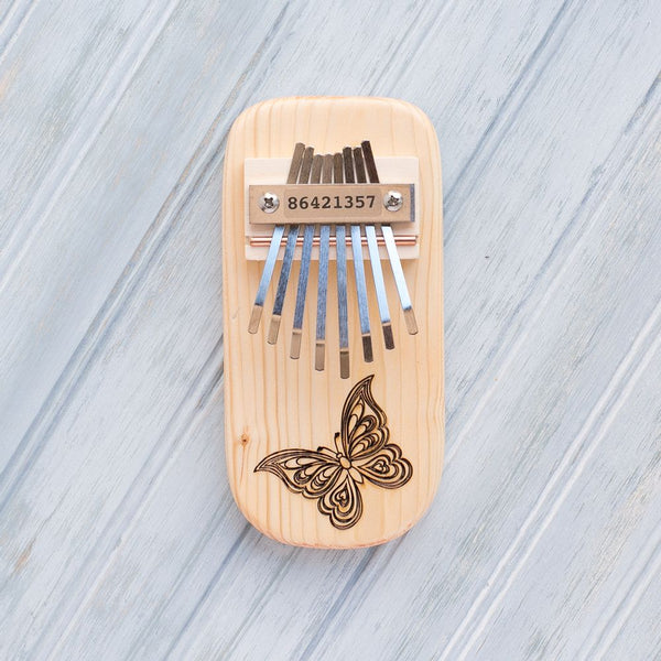 Butterfly Engraved Thumb Piano