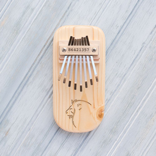 Lion Engraved Thumb Piano