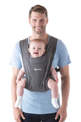 Father Using ErgoBaby Embrace Facing Out Carrier