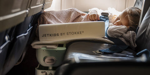 A child sleeping in flight with Stokke JetKids BedBox - ANB Baby