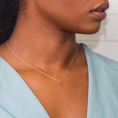 Camillette Jewelry Orb necklace in 14k yellow gold. Handmade in Montreal.