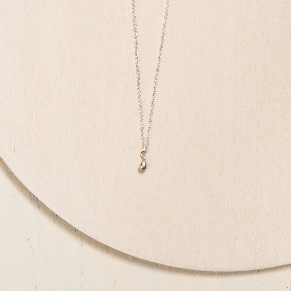 Tiny drop trinklet necklage in 10k white gold for woment handcrafted by Camille Ouellette