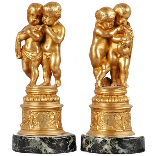 Pair of ormolu putti groups, France, c.1875