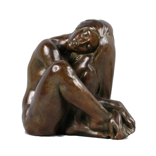 Bronze sculpture of a seated nude woman, Signed