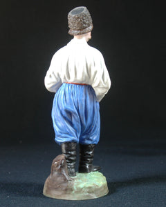 Gardner biscuit porcelain figure of Cossack with a pipe, Russia, c.1890